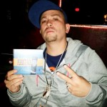 Ibe Hustles with his copy of Persistence in Colorado Springs
